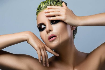 Woman with wet eyeshadows