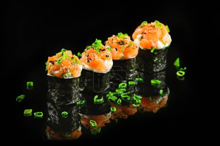 Photo for Sushi foursome on black background - Royalty Free Image