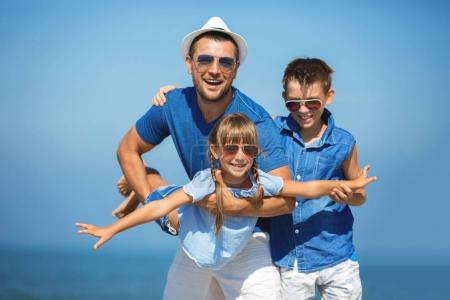 Photo for Father with children having fun.  Summer, family, vacation concept - Royalty Free Image