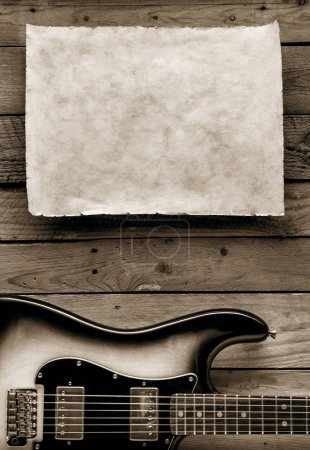 american music concert poster with guitar and paper sheet