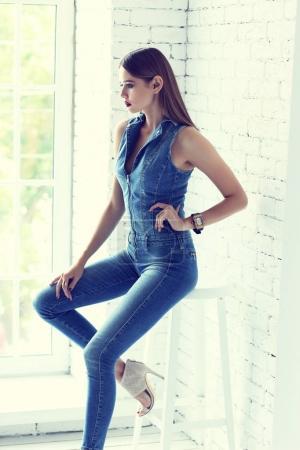 model in skinny overall