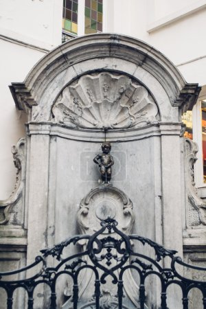 BRUSSELS, BELGIUM: a fountain with original Manneken Pis sculpture in the old town in Brussels at day time, Belgium circa February 2012.