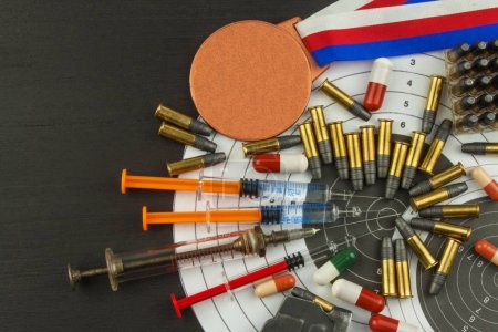 Syringe and medals Doping in