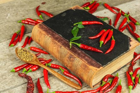 Book of old cookery recipes and fresh chili peppers. Spicy cuisine. Mexican food.