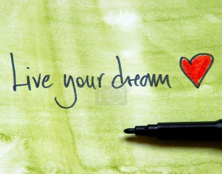 Photo for Hand drawn inscription Live your dream with heart on green watercolor background - Royalty Free Image