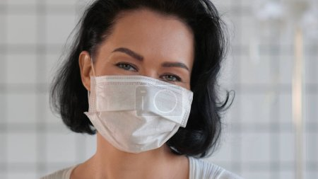 Photo for Close up. Happy smiling female wearing protective medical face mask. Professional shot. 052. You can use it e.g. in your commercial, medical, business, presentation, broadcast - Royalty Free Image
