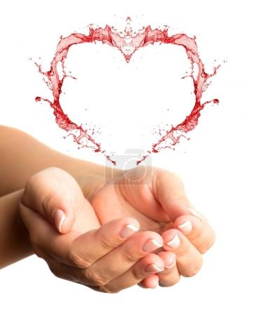 Woman hands with heart shape