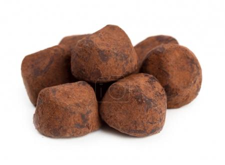 Photo for Close up view of chocolate truffles isolated on white background - Royalty Free Image