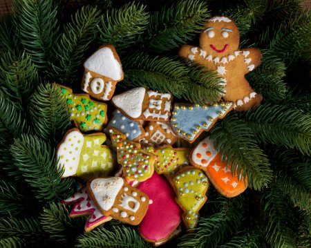 Gingerbread on fir tree background