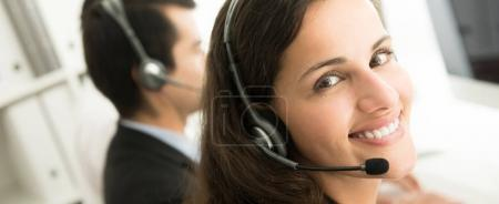 Photo for Smiling customer service staff in call center, panoramic banner - Royalty Free Image