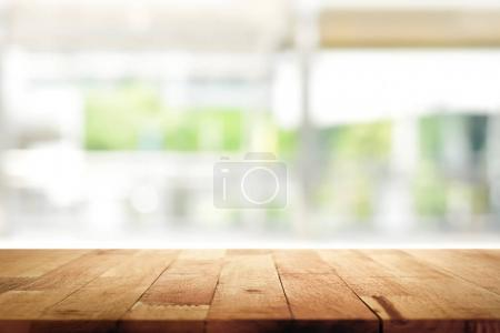 Photo for Wood table top on blur kitchen window background - can be used for display or montage your products (foods) - Royalty Free Image