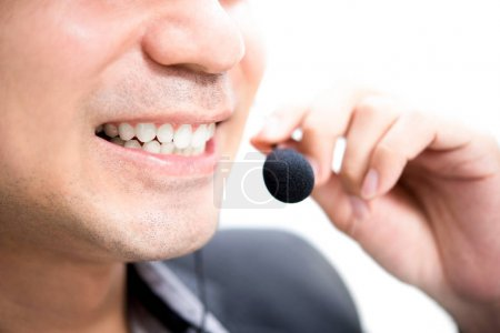 Smiling male call center worker