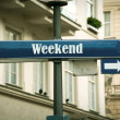 Street Sign the Direction Way to Weekend...