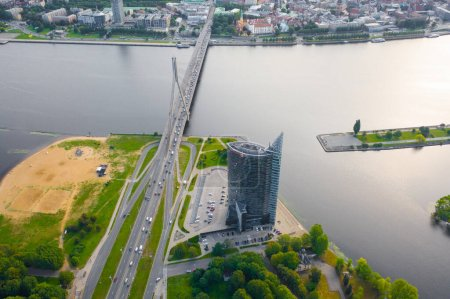 Beautiful Aerial view photo from flying drone panoramic on Vansu Bridge in Riga is a cable-stayed bridge that crosses the Daugava river in Riga. RIGA, LATVIA