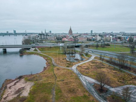 Beautiful Aerial view photo from flying drone panoramic view of Riga's bridges, the Daugava River, the TV Tower and the city skyline in January. Riga, Latvia