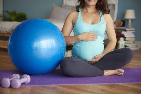 Pregnant woman do some yoga
