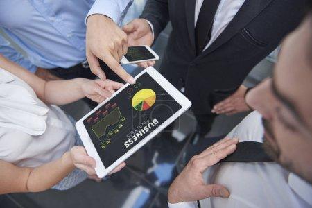 Business people browsing a digital tablet