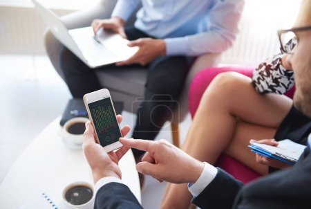 Mobilephone used during the business meeting