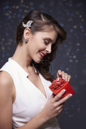 Surprised woman with red present