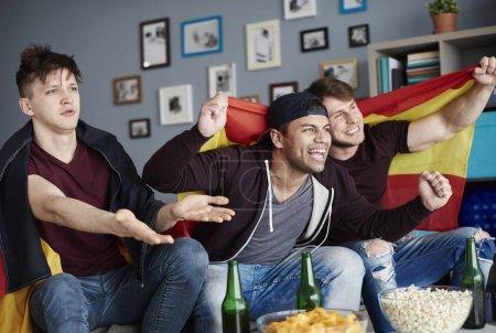 Friends watching sport game