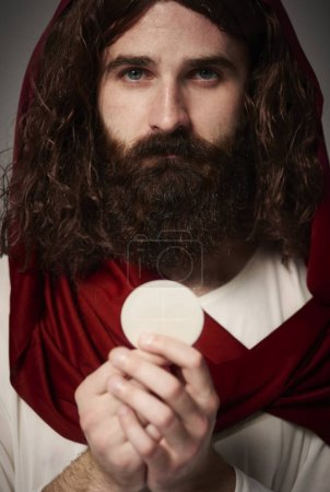 Jesus holding holy Eucharist