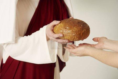 Jesus holding bread