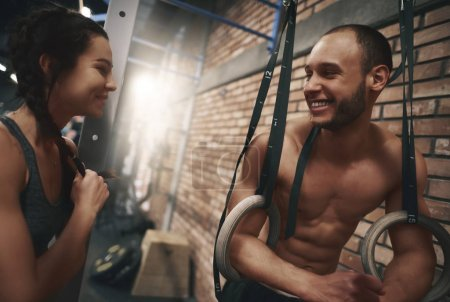 man and woman smiling at gym