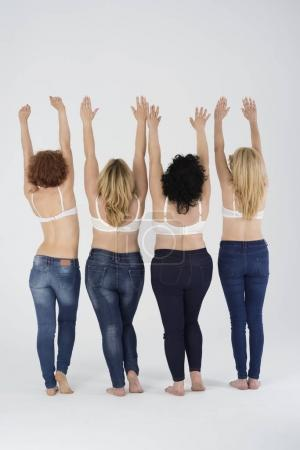 Four women in bras and jeans