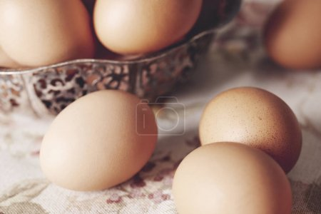 Photo for Close up of brown eggs on table - Royalty Free Image