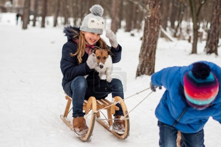 Photo for Emotional family winter photo shoot with Jack Russell. - Royalty Free Image