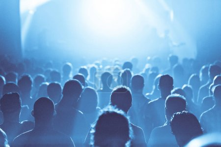 Photo for Back lit Blue ambiance and and Crowd in silhouette during a Concert - Royalty Free Image