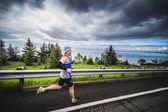 Marathoner Alone going Down the Hill
