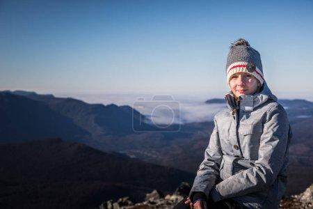 Woman Enjoying the View of the Richardson Mountain's
