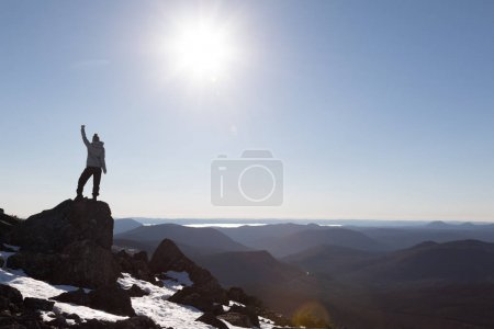 Woman Enjoying the Success of the Richardson Mountains
