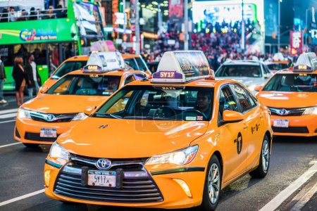Photo for NEW YORK, USA - October 14, 2016. Details of Yellow Cabs in the Middle of Times Square at Night, Manhattan, New York - Royalty Free Image