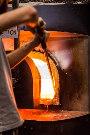 Glassmaker Picking Melted Piece of Glass