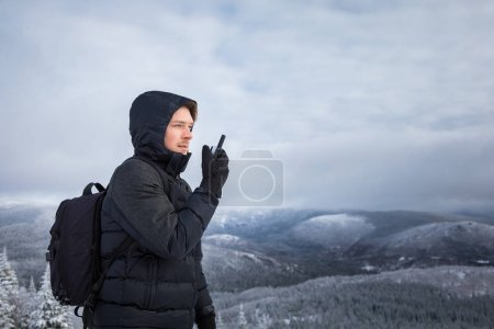 Photo for Young Man Alone on top of Mountain during Winter - Royalty Free Image
