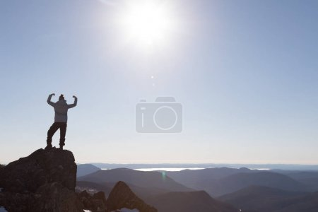 Victorious Woman Enjoying the Success on Mountain