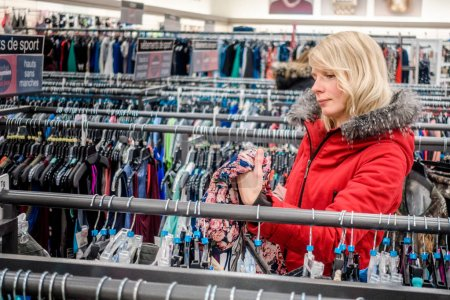 Woman Looking for Deals in a Winners Store