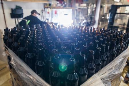 Stack of empty beer bottles