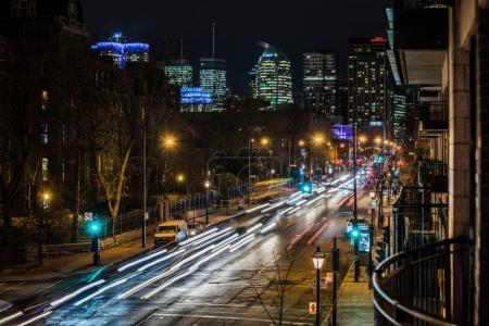 Montreal, Canada - November 22, 2017: Sherbrooke Traffic Cars Lights during the Evening Rush Hour