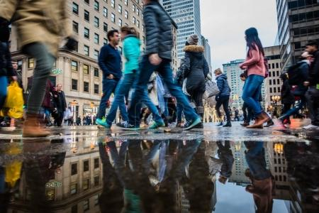 Montreal, Canada - November 25, 2017: People with Motion Blur Walking Fast During Shipping Hour on Ste-Catherine Street before Xmas