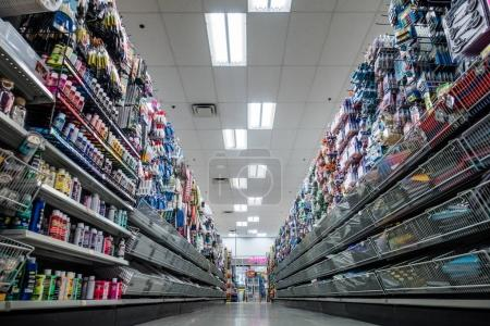 Montreal, Canada - November 27, 2017: Close-up of Dollarama Retail Store Indoor Aisle with Toys, Furnitures and all the Cheap Items Available.