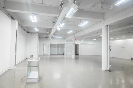 Montreal, Canada - November 27, 2017: Empty White Local for Rent on St-Laurent street in Montreal.