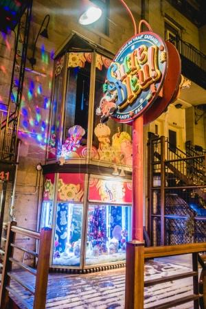 Montreal, Canada - November 28, 2017: Exterior and Sign of Sucre Bleu Commerce on St-Denis Street which is a Well Known Candy Shop in Montreal