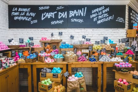 Montreal, Canada - November 29, 2017: Inside Lush Shop in Montreal on St-Denis Street. Wide shot of the Wall and Display of Different Soap and Bath Bombs.