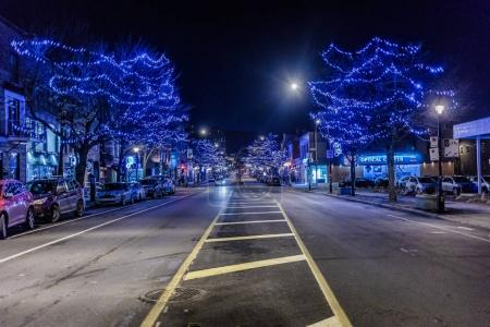 Montreal, Canada - November 30, 2017: Mount-Royal Street with Christmas Night Decoration Light.