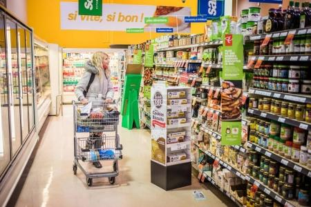 Montreal, Canada - November 30, 2017: Young Woman at the Provigo Grocery Alone in the Aisle with a Small Cart