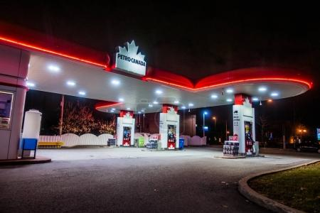 Montreal, Canada - December 1, 2017: Petro Canada Commerce and Gas Station Illuminated Late at Night