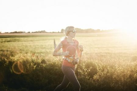 Woman running on rural fields